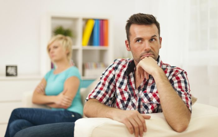 how to deal with taking a break in a relationship concept, couple sitting on couch